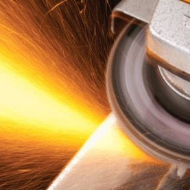 Close up of angle grinder with sparks