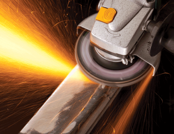 Angle grinder being used to clean up weld and creating sparks